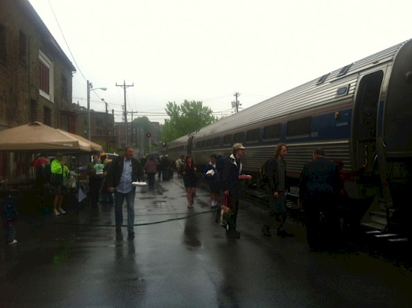 The southbound Vermonter makes its station stop at Brattleboro at noontime on a damp Train Day.